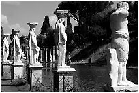 Antique statues along the Canopus, Villa Hadriana. Tivoli, Lazio, Italy (black and white)