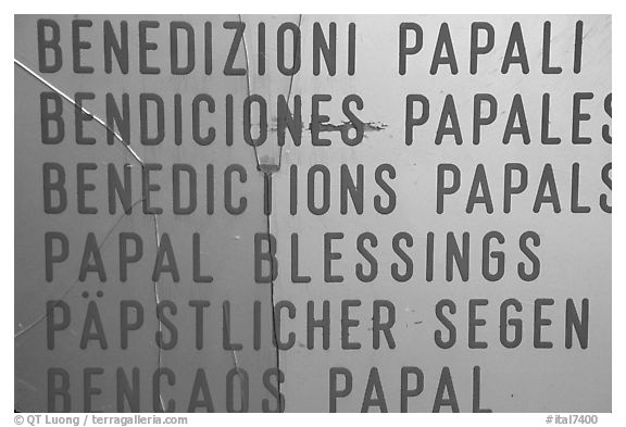 Papal Blessings sign in many languages. Vatican City (black and white)