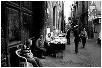Via San Giogio dei Librai, one of the liveliest roads in Spaccanapoli. Naples, Campania, Italy ( black and white)