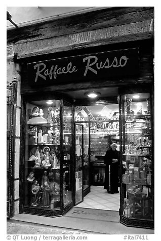 Store selling religious statuettes. Naples, Campania, Italy (black and white)