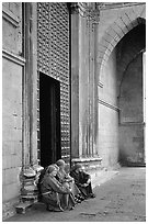 Nuns sit outside of one of  many churches of the historic town. Naples, Campania, Italy ( black and white)