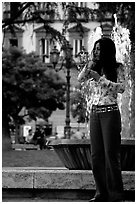 Young woman talking on a cell phone. Naples, Campania, Italy (black and white)