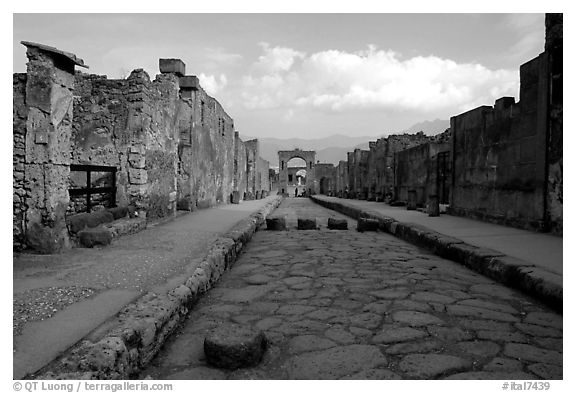 Street with roman period pavement and sidewalks. Pompeii, Campania, Italy (black and white)