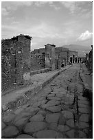 Paved street and ruins. Pompeii, Campania, Italy ( black and white)