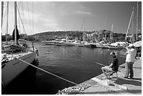 Fishing in the yacht harbor, Agropoli. Campania, Italy (black and white)