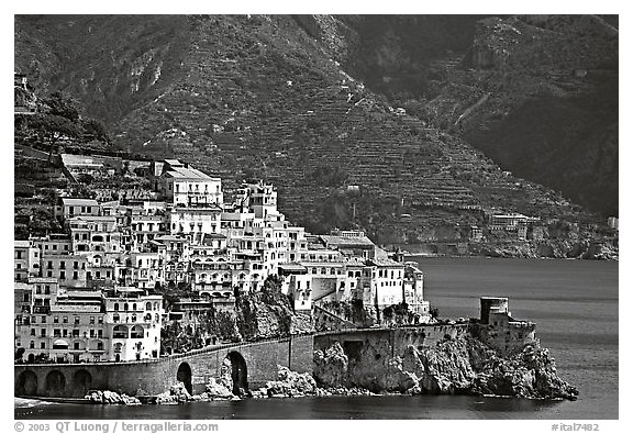 Houses built on a rocky promontory in Amalfi. Amalfi Coast, Campania, Italy (black and white)