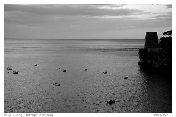 Small boats and tower and sunset, Positano. Amalfi Coast, Campania, Italy (black and white)