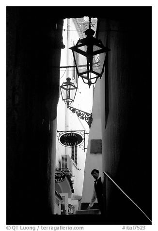 Narrow stairway with formally dressed man and hotel sign,  Amalfi. Amalfi Coast, Campania, Italy