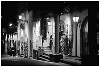 Expensive stores at night on Via Pasitea. Amalfi Coast, Campania, Italy (black and white)