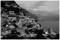 Positano lights coming up at dusk. Amalfi Coast, Campania, Italy (black and white)