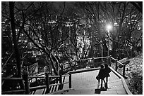 Couple walking down Namsan stairs by night. Seoul, South Korea ( black and white)