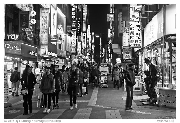 Shoppers on pedestrian street by night. Seoul, South Korea (black and white)