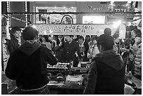 Street food by night. Seoul, South Korea (black and white)