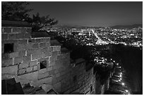 Rampart wall and city lights, Suwon Hwaseong Fortress. South Korea ( black and white)