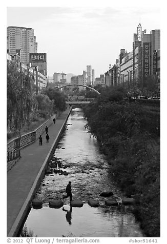 Man crossing Cheonggye stream. Seoul, South Korea (black and white)
