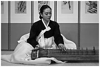 Woman playing traditional instrument. South Korea ( black and white)