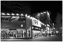 Pedestrian street lined up with outdoor equipment stores. Daegu, South Korea (black and white)
