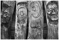 Sculptures on wood stems. Hahoe Folk Village, South Korea ( black and white)