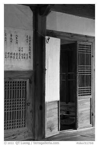 Wooden interior doors in residence. Hahoe Folk Village, South Korea (black and white)