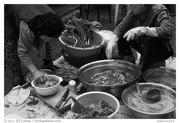 Women preparing kim chee. Gyeongju, South Korea (black and white)