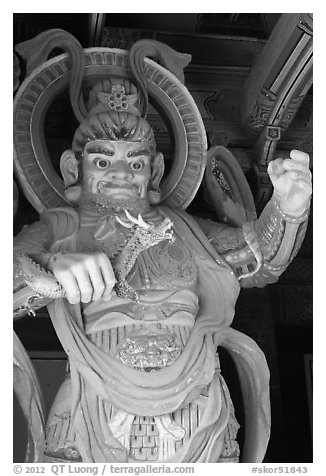 Painted statue with dragon, Bulguksa. Gyeongju, South Korea (black and white)