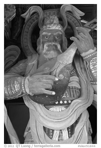 Wooden statue with musical instrument, Bulguk-sa. Gyeongju, South Korea (black and white)