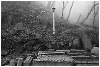 Stones and lantern in fog, Seokguram. Gyeongju, South Korea ( black and white)
