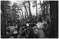 Large group of hikers eating on Geumobong Peak, Namsan Mountain. Gyeongju, South Korea ( black and white)