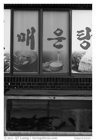 Fish tank and food pictures. Gyeongju, South Korea (black and white)