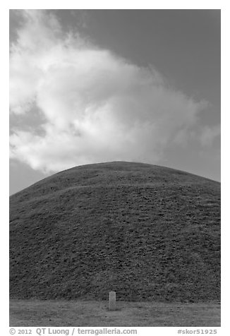 Mound of earth raised over grave and cloud. Gyeongju, South Korea (black and white)
