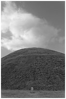 Mound of earth raised over grave and cloud. Gyeongju, South Korea ( black and white)