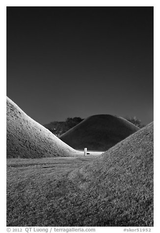 Grassy burial tumulus at night. Gyeongju, South Korea (black and white)