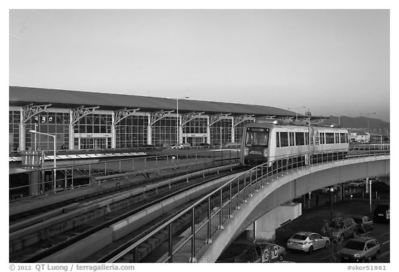 Subway on elevated bridge near airport, Busan. South Korea (black and white)