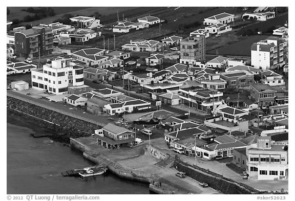 Houses with blue roofs, Seongsang Ilchulbong from above. Jeju Island, South Korea (black and white)