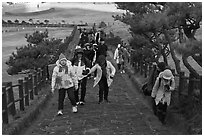 Tourists walking up path, Ilchulbong. Jeju Island, South Korea (black and white)
