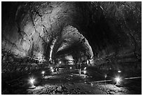 Manjanggul Lava cave with visitor standing. Jeju Island, South Korea (black and white)