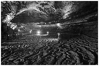 Floor with hardened lava flow in  Manjanggul cave. Jeju Island, South Korea ( black and white)
