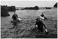 Women divers emerging from water. Jeju Island, South Korea (black and white)