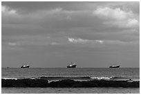Fishing boats offshore. Jeju Island, South Korea (black and white)