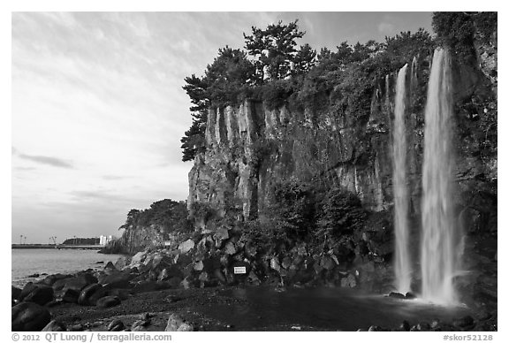 Jeongbang Pokpo, only waterfall in Asia dropping into sea, Seogwipo. Jeju Island, South Korea (black and white)