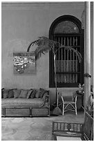 Chairs and blue wall, Cheong Fatt Tze Mansion. George Town, Penang, Malaysia ( black and white)