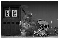 Trishaw, plant and door, Cheong Fatt Tze Mansion. George Town, Penang, Malaysia ( black and white)