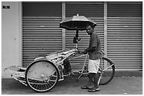 Driver and trishaw. George Town, Penang, Malaysia ( black and white)