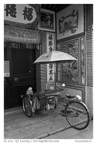 Bicycle rickshaw at temple entrance. George Town, Penang, Malaysia (black and white)