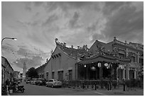 Temple and distant minaret at sunset. George Town, Penang, Malaysia ( black and white)