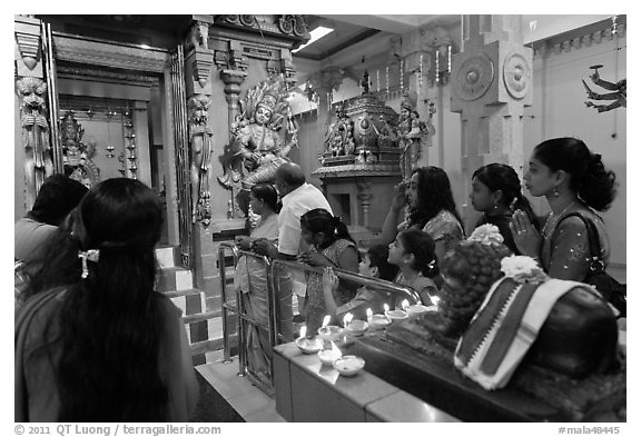 Devotees inside Tamil Nadu temple. George Town, Penang, Malaysia (black and white)
