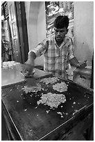 Man preparing indian food. George Town, Penang, Malaysia ( black and white)