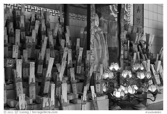 Tablets with names on altar, Kuan Yin Teng temple. George Town, Penang, Malaysia (black and white)