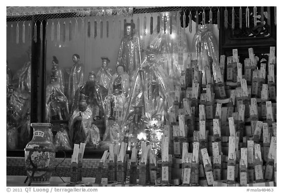 Statues and sticks, Kuan Yin Teng temple. George Town, Penang, Malaysia (black and white)