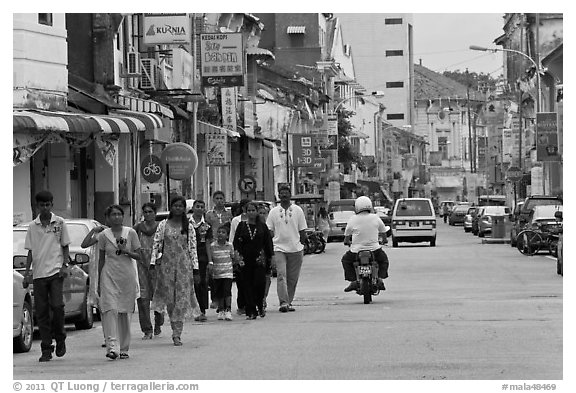 Malay people walking on street. George Town, Penang, Malaysia (black and white)